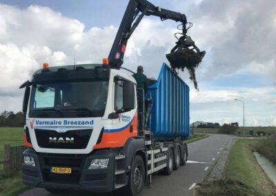 Vrachtauto MAN 8×4 container + kraan